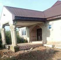 A 4 bedroom bungalow with 2 units of room and parlour self