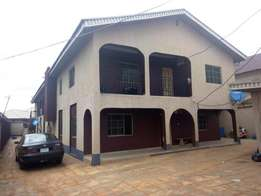 Decent renovated 2 bedroom flat all tiles floor upstairs at baruwa