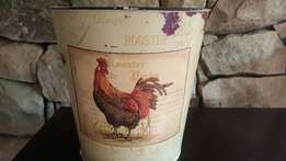 Rooster on bucket