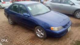 A clean registered toyota corolla for sale.