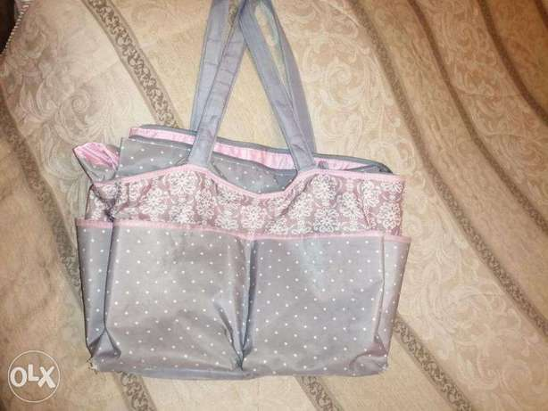 Baby bag color pink and grey 14$ = 20000 LBP