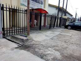 Ground Floor Open Space Facing Main Road To Let at Alagomeji Yaba