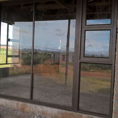 Aluminium doors and windows. Retractable security doors and barriers Secunda - image 3