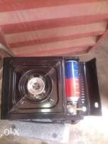 Traveling box cooker