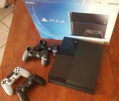 Playstation 4 with 2 remotes including 17 games **Cash Only**