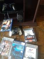 PlayStation 2 slim with 5 games