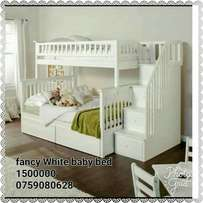fancy white baby bed