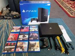 Playstation 4 pro 1TB console + 5 GAMES (W/RECEIPTS)