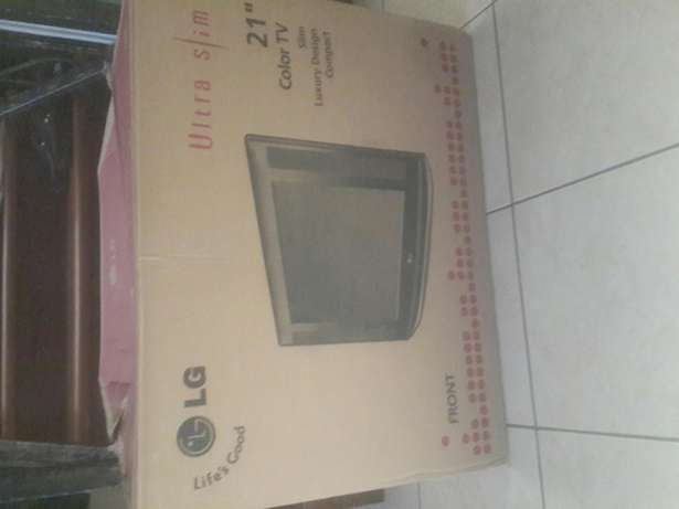 "COMBO PACKAGE PRICED TO SELL. 21""LG TV, DVD and Cabinet with Storage Langata - image 2"