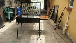 Traditional half drum braai stand with side table and wheels