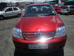 2003 toyota corolla ,4 doors ,maroon in colour ,98 000km ,for sale