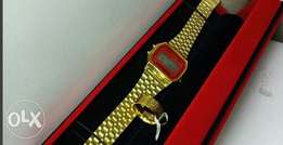 Gold Casio watch and versace ring on offer