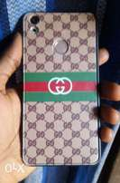 Gold Tecno Camon CX With Gucci case