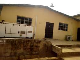 Super spacious land with uncompleted building along Ojodu for sale