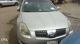 silver coloured 2004 Nissan Maxima