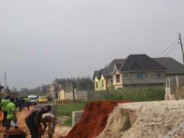 plot of land with C of O at Festac extention - Abule Ado