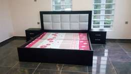 A 6 by 6 padded bed.