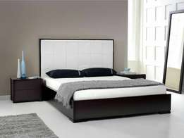 Black bed, its drawers and mirror