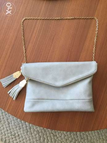 purse light gray with gold chain from US
