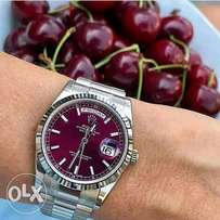 Silver tone Rolex with pink dial
