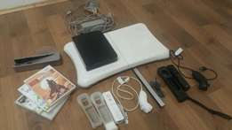 Wii console, games and fit board
