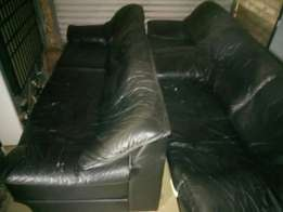 Black genuine leather 3 seated couches