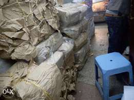 Bales of khaki grocery bags for sale.