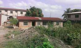 A 2bedroom flat with room and parlor self-contained FOR SALE.