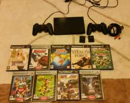 Bargain!! Complete Sony PS2 Slim with Two remotes and lots of games.
