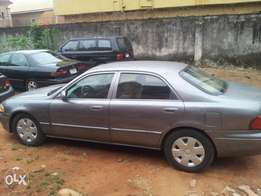 Neatly used mazda saloon for sale