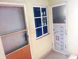 Lovely renovated Mini flat all tile floor fenced gate water at Baruwa