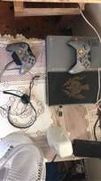 limited edition xbox1 with 2 controllers a d 8 games