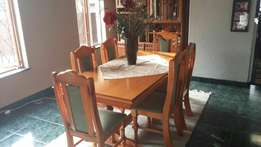 Dining room table with wall cabinet
