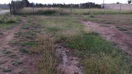 A five(5) acres land at kamulu for sale.