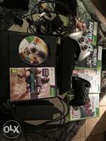 Xbox 360 console with two controllers and 6 games.