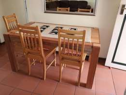 Solid Meranti table and 3 x oak riempies chairs