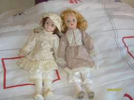 Two collectable porcelin dolls for sale