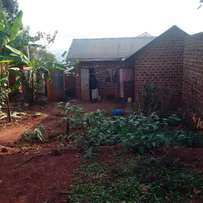plot with house 60by40 along entebbe katale road,,