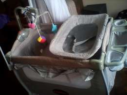 camp cot, feeding chair and baby gym