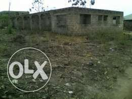 2 plots of land with uncompleted twin flat.