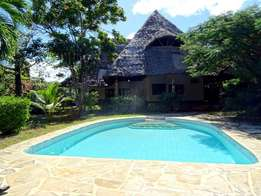 Beautiful Unique Three bedroom Bungalow Diani off beach rd. for sale