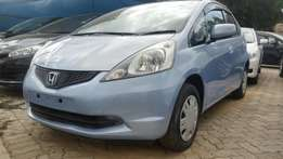 Clean Honda Fit light blue 2009 model buy on bank/hire-purchase