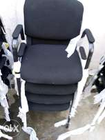 Classy visitor's chair with hand-rest