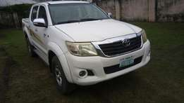 Super clean 2009 but upgraded to 2013 model Toyota Hilux for sale