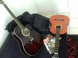 2x Guitars with learner books