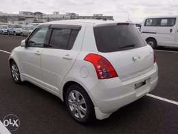 Suzuki Swift 2010 Pearl White fully loaded KCP