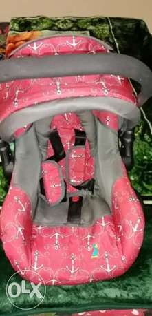 Baby rocker/baby carrier