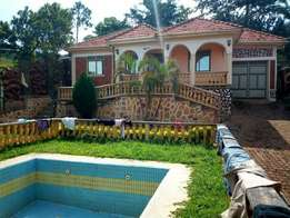 A world class 3bedroomed house for sale located along Entebe at 200m