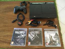 Playstation 3 with three games and bluetooth ear piece