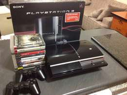 PS3 with 2 controllers with box almost new , loads of games